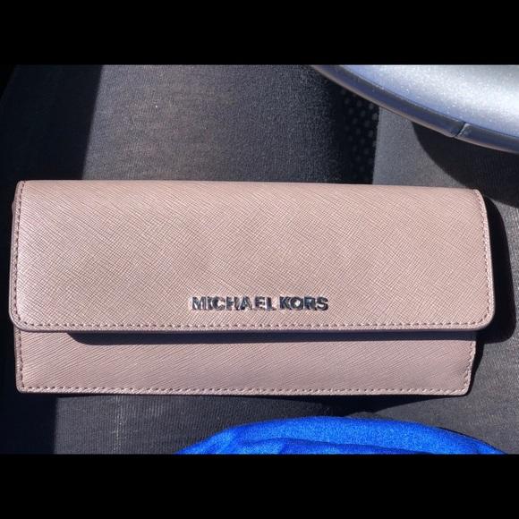 e4b67eb8378c Jet Set Travel Slim Saffiano Leather Wallet. M_5adb617a3afbbd4d90fef0ff